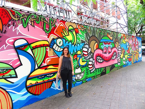 Photo of Laura in front of street art in Barcelona